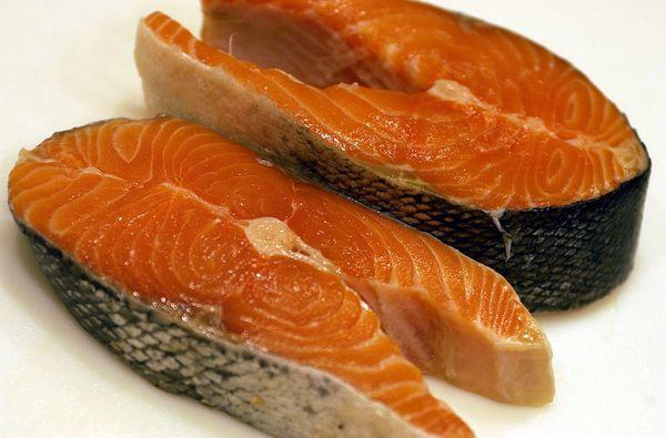 Some salmon steaks. Genetically modified salmon drew closer to FDA approval with publication last week of a long-awaited assessment of environmental effects of the fish.