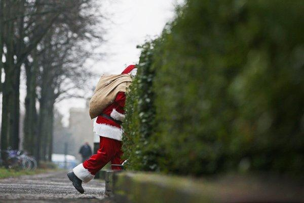 A man dressed as Santa Claus walks through a street in Hamburg, Germany.