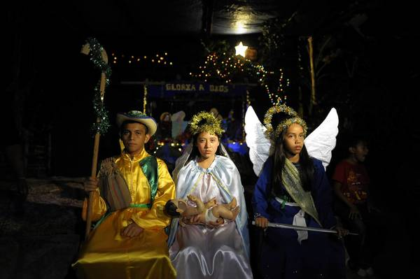 "Children dressed as biblical characters participate in a ""pastorela"" last week in Santo Tomas, El Salvador. Pastorelas are plays that recreate the biblical passage where the shepherds follow the star of Bethlehem to find the Christ child."
