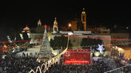 BETHLEHEM, West Bank -- Thousands of tourists joined Palestinians in the West Bank city of Bethlehem on Monday for  Christmas Eve in the biblical birth place of Jesus Christ.
