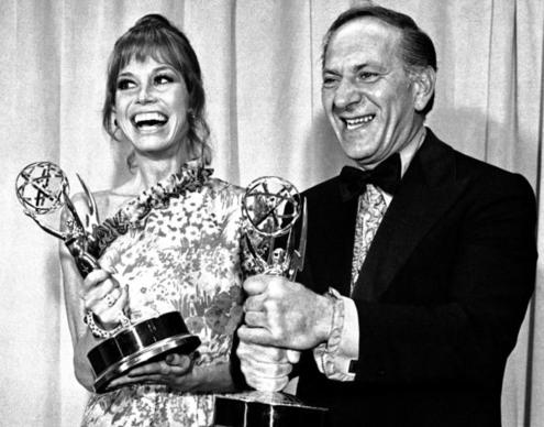 """Mary Tyler Moore and Jack Klugman hold the Emmys they won in 1973 for best actress and actor in a comedy series. Moore won for """"The Mary Tyler Moore Show"""" and Klugman for """"The Odd Couple."""""""