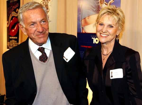 "Actor Jack Klugman, left, and Peggy Crosby, right, arrive for a special reception for director Blake Edwards, who was to receive an honorary Oscar at the 76th Academy Awards ceremony.  Klugman starred in Edwards' ""Days of Wine and Roses."""
