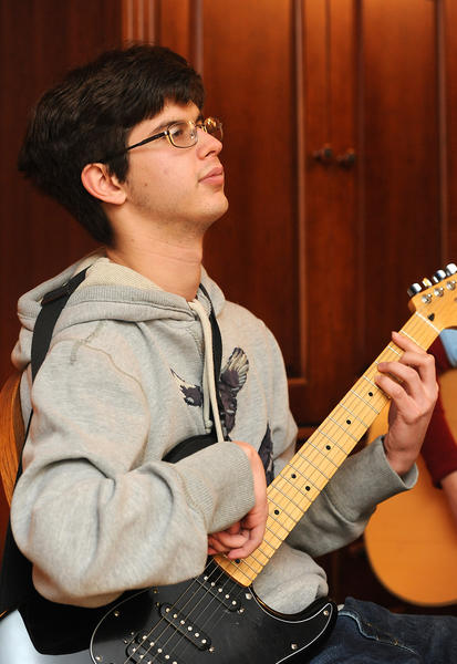 Christopher Beamer 20, takes Music Therapy Lessons from Steph Falcone, a Music Therapist-Board Certified in instructor in his Center Valley home.