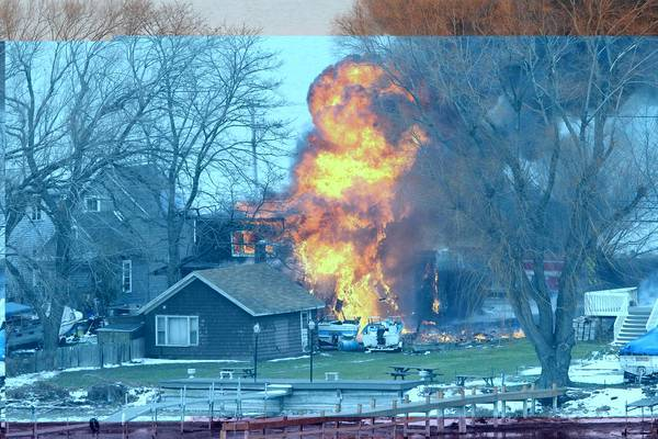 A house burns in Webster, N.Y., where an ex-convict started a blaze and began shooting at responding firefighters.