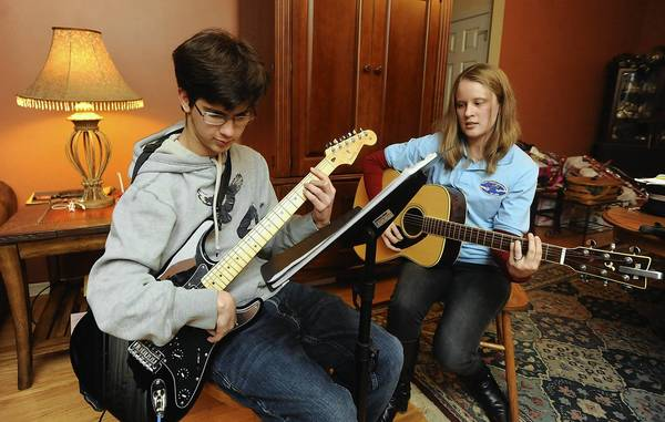 Christopher Beamer, 20, takes music therapy lessons from Steph Falcone.