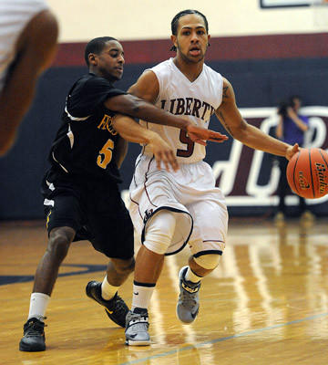 Freedom's Nigel Long (left) guards Liberty's Chevon Williams (right) in the second quarter of their Lehigh Valley Conference boys basketball game Friday night.
