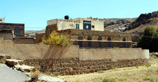 A painting of the black flag brandished by the militant group Al Qaeda in the Arabian Peninsula marks the wall of Adnan Qadhi's house in the Yemeni village of Beit al Ahmar. Qadhi was killed by a U.S. drone strike in November.