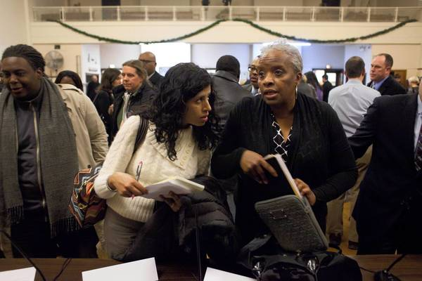 Consultant Avani Patel, left, talks with mayoral adviser Desiree Tate after a school utilization meeting.