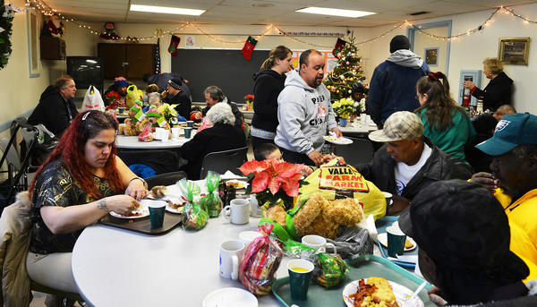 People enjoy a Christmas breakfast during a New Bethany Ministries Christmas Day breakfast. The celebration included a Christmas service, presents for the children and a breakfast buffet on Christmas Day.