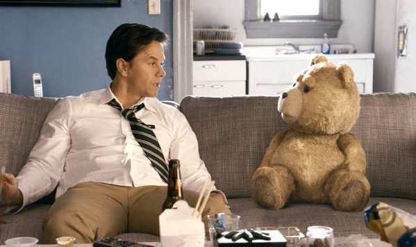 "John, played by Mark Wahlberg, hangs out with his best friend, Ted, voiced by Seth MacFarlane, in the live action/CG-animated comedy ""Ted."""