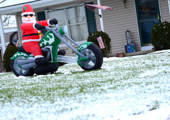 Santa rides his motorcycle in this lawn ornament on Copeechan Road near rt. 873 in the Schnecksville area Tuesday. Snow that fell on Christmas Eve left the Lehigh Valley area under a white blanket early Christmas Day, 2012.