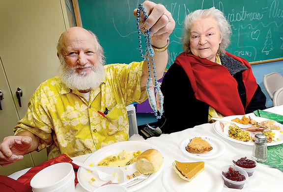 Donald Hutson, left, of Hagerstown holds up the ¿Two Carrot¿ necklace he got his wife, Shirley Mae Hutson, right, for Christmas Tuesday morning during the annual Shepherd's Table Christmas dinner at Rehobath United Methodist Church in Williamsport. Hutson taped two baby carrots to a plastic necklace.