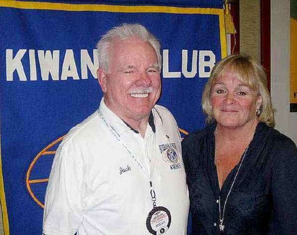 Burbank Sunrise Kiwanis President Jack Reardon welcomed Laurie Bleick, executive director of the Family Service Agency, to a recent meeting and presented her with a check to support the agency's counseling services.