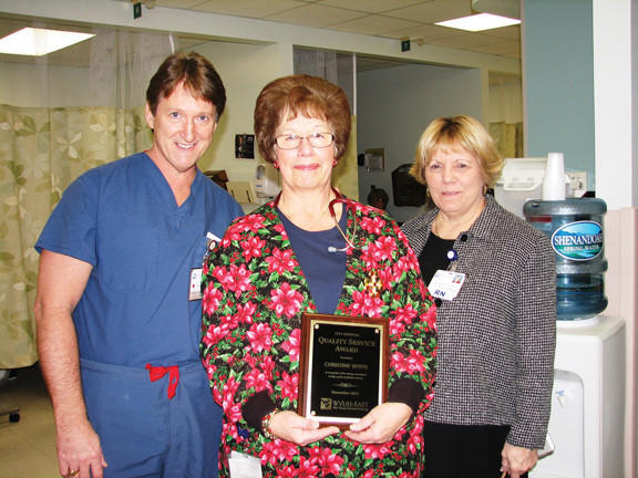 City Hospital's November Quality Service Award winner Chris White, center, receives her award from Steve Folmer, left, director of surgical services, and Donna Clews, vice president of patient care services.