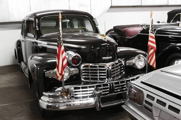"This 1942 Lincoln on display at the Petersen Automotive Museum's ""vault"" was ordered the day after the attack on Pearl Harbor for President Franklin Roosevelt. It built with steel plating nearly a quarter of an inch thick and has windows made up of nine panes of laminated glass."