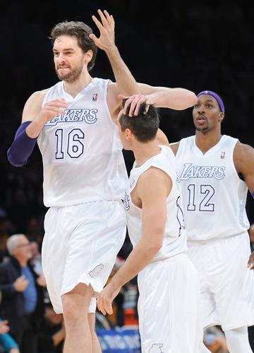 Lakers power forward Pau Gasol (16) celebrates with point guard Steve Nash after throwing down a dunk that helped seal a 100-94 victory over the Knicks on Tuesday at Staples Center.