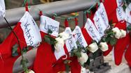 Memorials to the Sandy Hook Elementary School victims flourished on Christmas Day as Newtown, Conn., police got a break from holiday duty, with officers from nearby jurisdictions relieving them.
