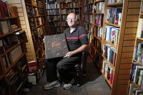 "Clarey Rudd, owner of the new Bank of Books, Malibu, holds an 1877 copy of ""Faust: A Tragedy,"" on sale for $6,850. For a brick-and-mortar bookstore to survive today, the basics are not enough. So Rudd has learned to customize, and to cater to his clients."