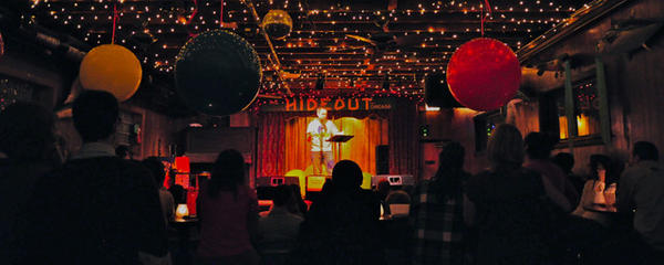 Ian Belknap oversees a Write Club event at Hideout.
