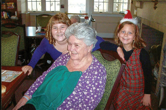On Dec. 15, children from Calvary Temple, 147 S. Conococheague St., presented residents of Williamsport Nursing Home with Christmas cards they made for the residents. Vivian Smith, center, a resident of the nursing home and a member of Calvary Temple, is shown with Treya Millman, left, and Shelby Moats as she enjoyed the children's visit.
