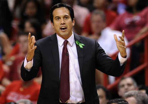Miami Heat head coach Erik Spoelstra argues a call with an official during the second half of their NBA basketball game against the Oklahoma City Thunder in Miami, Florida, December 25, 2012.