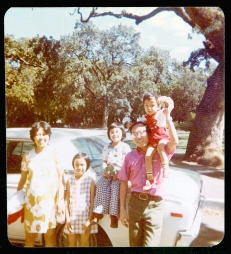 "The Do family, from left: mother Loan (""Ma""), Anh, Dao, father Yen (""Bo"") and Tung pose at a neighborhood park with the car that had been donated to them, just weeks before the birth of daughter Lin, the first Do family member to be a U.S. citizen, in October 1975."
