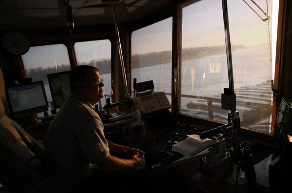 Capt. Paul Roos pilots the towboat LJ Sullivan's 16 barges down the Mississippi River near Cairo last week.