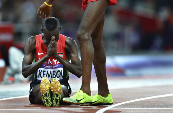 Kenya's Ezekiel Kemboi prays after winning the 3,000-meter steeplechase at the London Olympics.