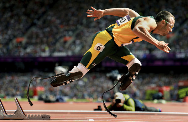 South Africa's Oscar Pistorius takes off from the starting blocks in the first round of the men's 400-meter race at the London Olympics. Pistorius became the first double-leg amputee to ever compete in the Olympics.