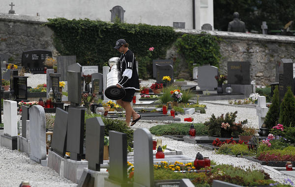 Kings center Anze Kopitar delivers the Stanley Cup to the gravesite of his grandmother, Fanci Kopitar, at the Church of St. Micheal in Dovje, Slovenia. Fanci was a big supporter of Anze, often skating with him on his homemade rink in the backyard of his home in Hrusica.