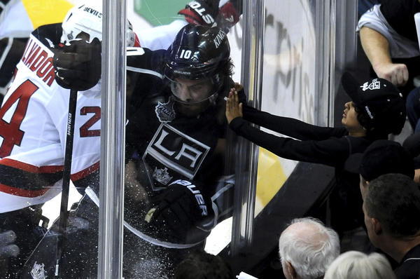 The Kings' Mike Richards gets checked into the boards by New Jersey's Bryce Salvador in Game 3 of the Stanley Cup Final at Staples Center. The Kings won the Stanley Cup Finals in six games.