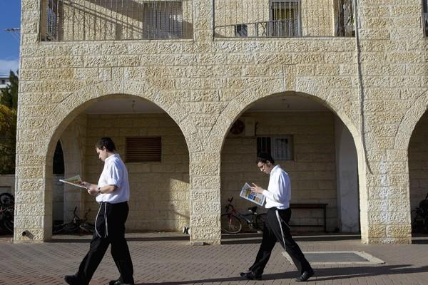Ultra-Orthodox Jews make their way in the Ramat Shlomo development in Jerusalem, where the Israeli government has approved construction of 1,500 housing units.