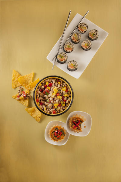 Zesty black-eyed pea salsa and Sola sushi rolls are great appetizers at a party.