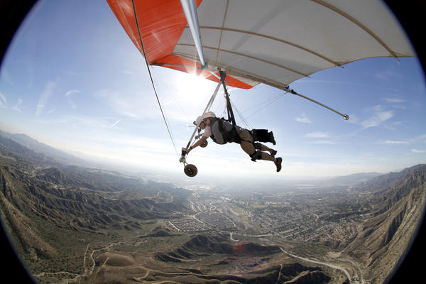 Reporter Jack Dolan hitches a ride with veteran flyer Fred Ballard over Sylmar. As the average age of hang glider pilots soars into the 60s and 70s, their sport, which was born in Southern California, teeters on the brink of extinction. Replacing them, a younger breed of pilots who favor a soft wing -- a steerable parachute, really -- pioneered by French alpineists looking for something compact they could stuff in a back pack that would offer suitably stylish descents from rugged peaks. To a layman, they're all gravity-defying daredevils but hang gliders and paragliders often regard each other with surprising contempt.