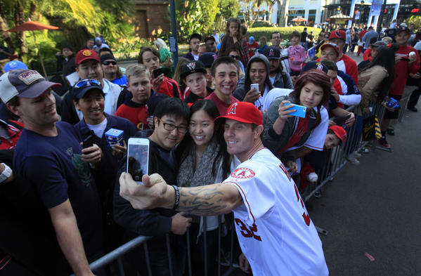 The Angels' newest signing, outfielder Josh Hamilton, takes a photo with fans after a news conference to introduce him. Hamilton, considered the best hitter in the free-agent pool, signed a five-year, $125-million deal with the Angels.