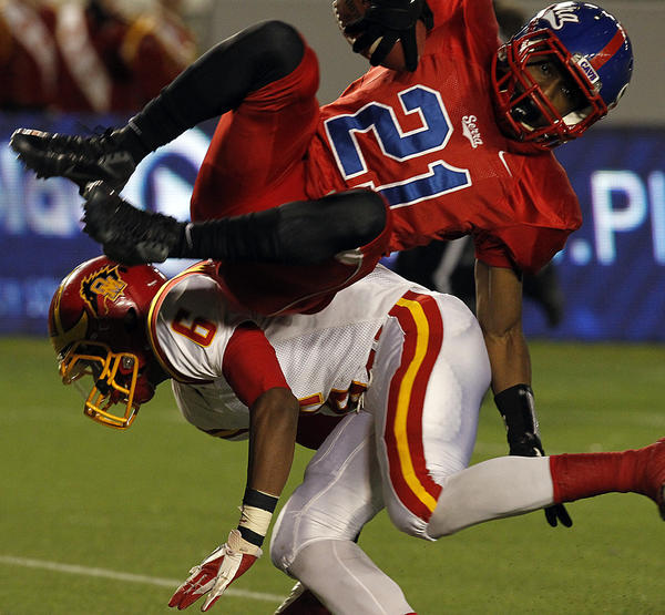 Gardena Serra wide receiver Adorre Jackson tumbles through the air and into the end zone after a hit by Oakdale's Dewayne Finney in the second quarter of the CIF Division II State Championship. Serra won the title, 42-15.