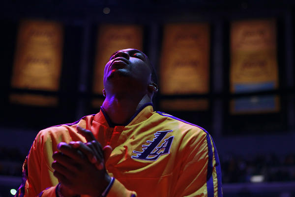 Lakers center Dwight Howard at midcourt during the national anthem before a game against the Clippers at Staples Center. He was acquired before the season in a three-team trade that sent center Andrew Bynum to the Philadelphia 76ers.