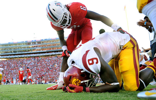"USC receiver Marquise Lee is consoled by Arizona's Jonathan McKnight after failing to make a reception on a ""hail Mary"" pass at the end of their game in Tucson. Lee was one of the few bright spots for USC, finishing fourth in the Heisman Trophy balloting."