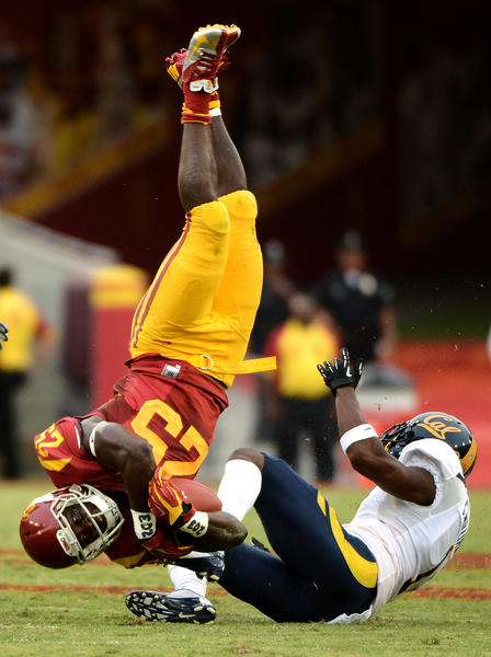 USC's Silas Redd gets flipped after being hit by Cal's Steve Williams in the fourth quarter at the Coliseum. Redd transfered to USC from Penn State before the season started.
