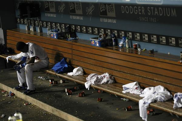 Dodgers shortstop Dee Gordon sits alone in the dugout minutes after the Dodgers were eliminated from a possible playoff berth with a 4-3 loss to the Giants at Dodger Stadium.