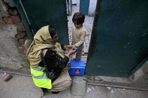 A child receives polio vaccine last week in Lahore, Pakistan. Since 1990, the death rate of kids younger than 5 has declined by 60 percent worldwide, according to a report produced at the University of Washington.