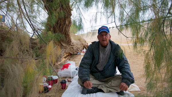 Ronald Luther, 56, is on his way to ' Georgia or Washington, D.C., whichever comes first.' Luther, who has a campsite under a tree next to Interstate 8, is one of countless travelers who come through Imperial County every year.