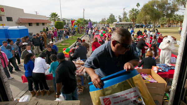 Salvation Army volunteer Pedro Ahumada moves a barrel holding goods distributed to residents during Tuesday¿s Christmas Day lunch.