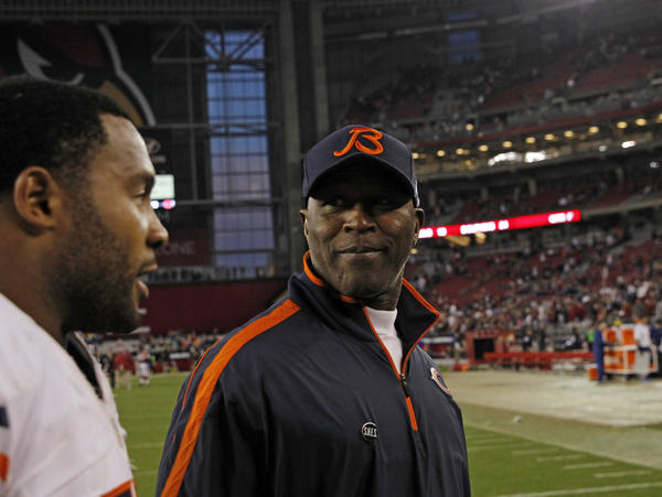Bears coach Lovie Smith and outside linebacker Lance Briggs head to the locker room after beating the Arizona Cardinals on Sunday.