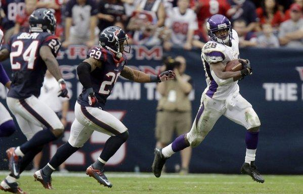 Adrian Peterson rushes against the Houston Texans.