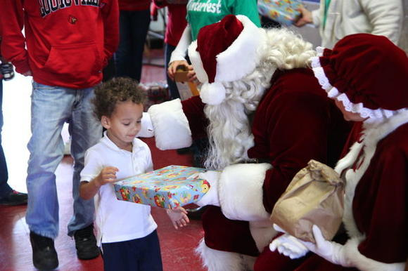 Lincoln kids treated to gifts, meal and Santa visit
