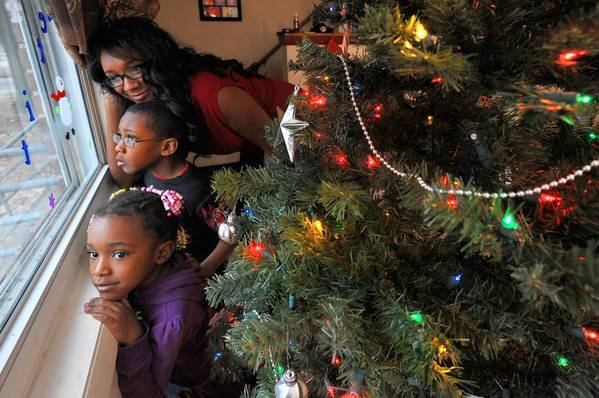 Christina Stocks will be able to celebrate Christmas with her children, Terence, 6, and Aaliyah, 5, with the help of a new United Way program.