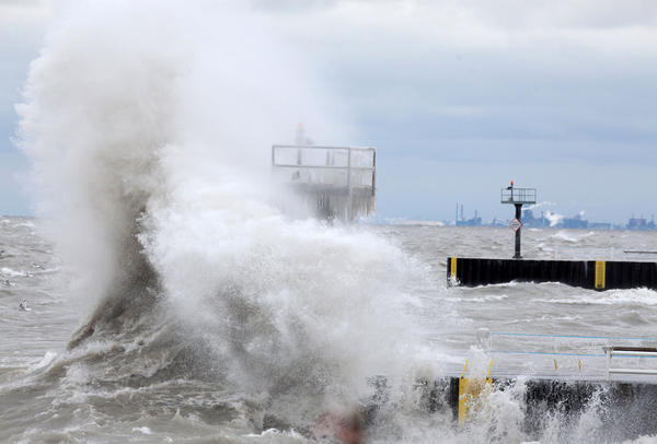 Waves crash on the breakwater at the 39th Street beach in Chicago. Unlike downstate Illinois which is under a winter weather advisory, Chicago is only expecting a cloudy, windy day, with temperatures in the low 30s.