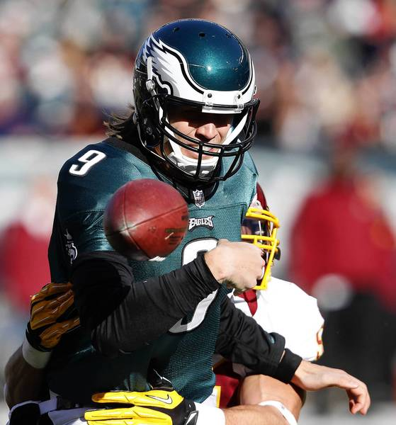 Philadelphia Eagles quarterback Nick Foles fumbles the ball, as he is hit by Washington Redskins' Ryan Kerrigan, right, during the 1st quarter at Lincoln Financial Field on Sunday, December 23, 2012, in Philadelphia. Foles has been placed on injured reserve by the Eagles.