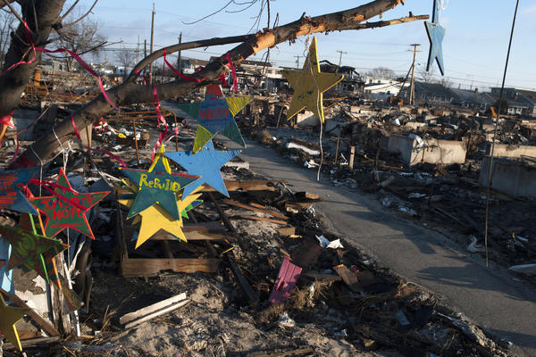 Christmas ornaments sit amongst the remains of homes destroyed by fire during Hurricane Sandy in the Breezy Point area of New York's borough of Queens.